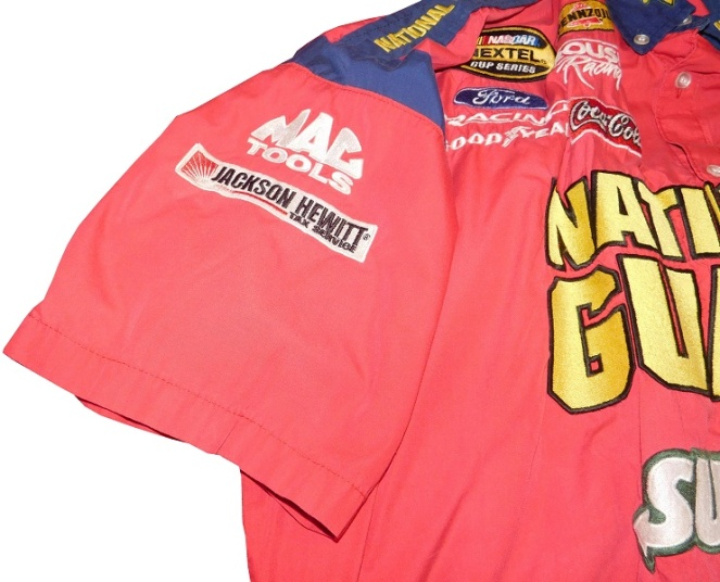 4e8e68c3 The right sleeve has MAC TOOLS and JACKSON HEWITT logos, and the left  sleeve has NASCAR, FORD RACING, and LABOR READY logos embroidered into it.